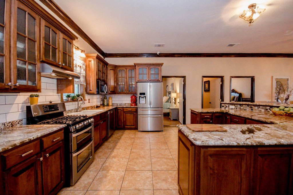 open kitchen with granite countertops
